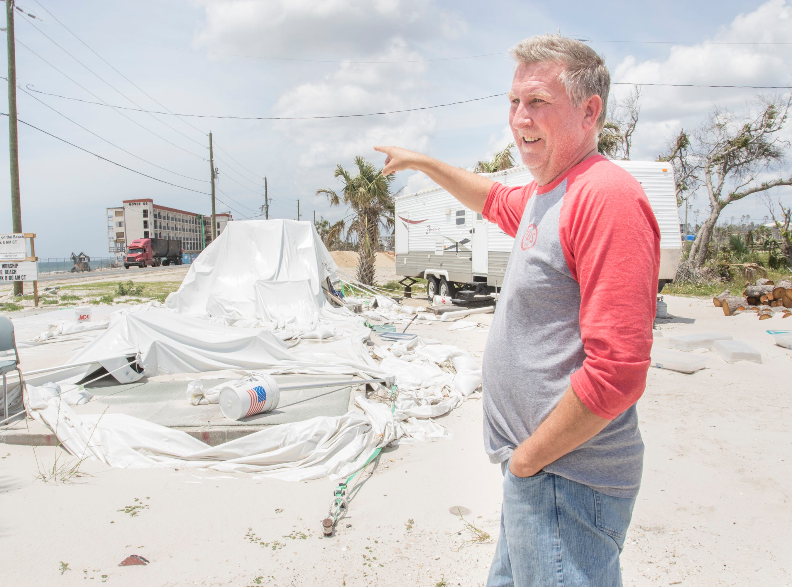 David Gieseking, pastor of Living Water Church at the Beach, talks about surviving Hurricane Michael that destroyed his church that once stood in on his property in Mexico Beach on Wednesday, May 8, 2019.  Gieseking also lost his house and is now living in the RV on next to the foundation of his church.
