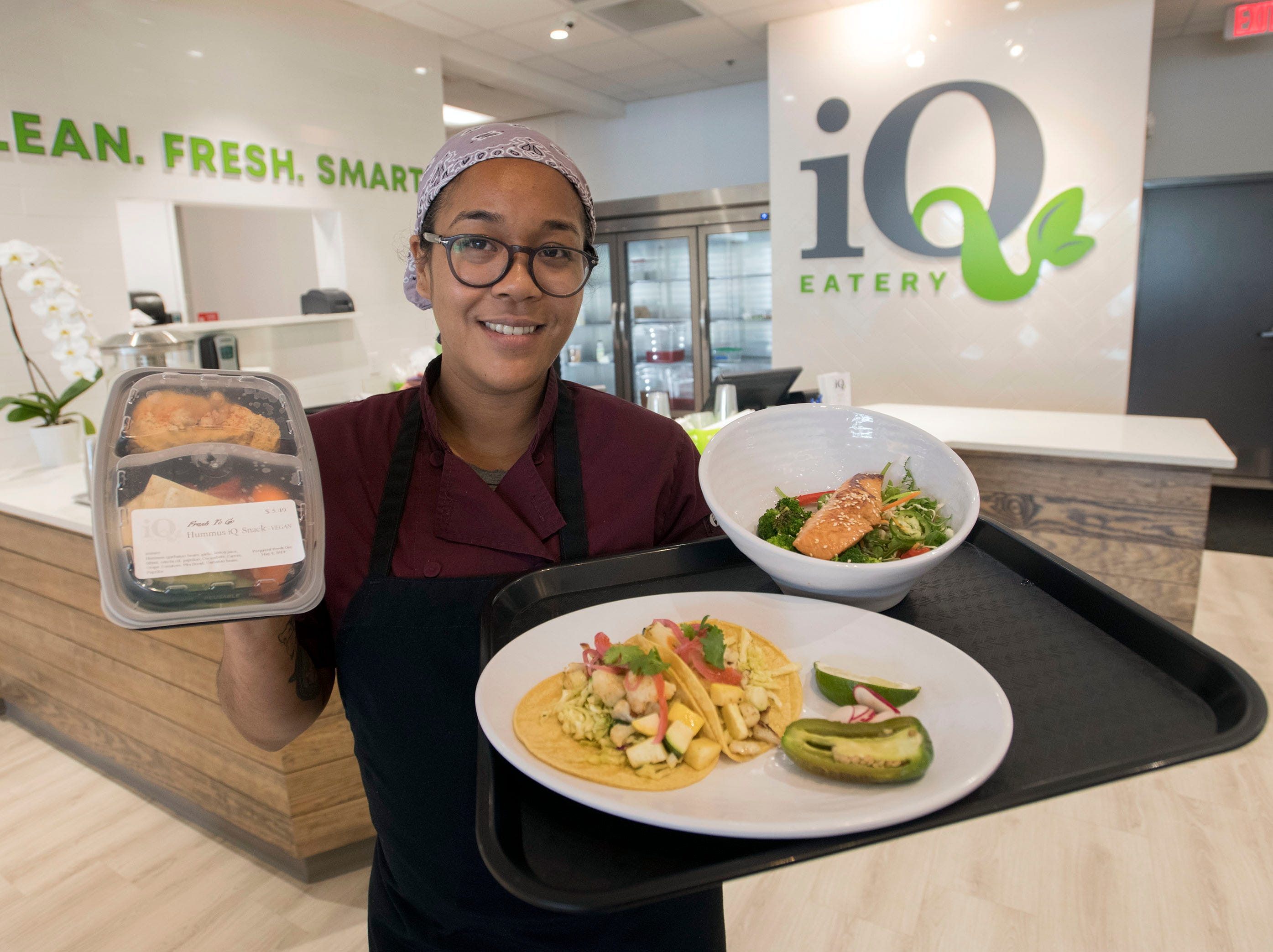 Chef Takara Hein shows off some of the made to order meals and the ready-made food options available at the new Barrancas Ave restaurant, IQ Eatery on Thursday, May 9, 2019.