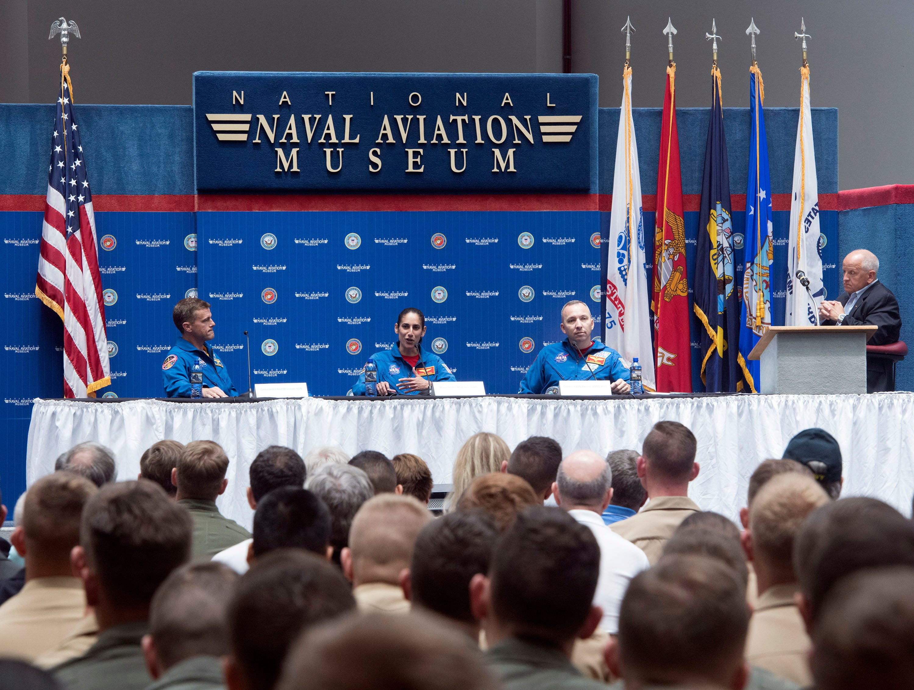 Maj. Jasmin Moghbeli describes her training as an astronaut during a panel discussion while fellow astronauts, Cmdr. Reid Wiseman and Col. Randy Bresnik look on during the Naval Aviation Symposium on Thursday, May 9, 2019.
