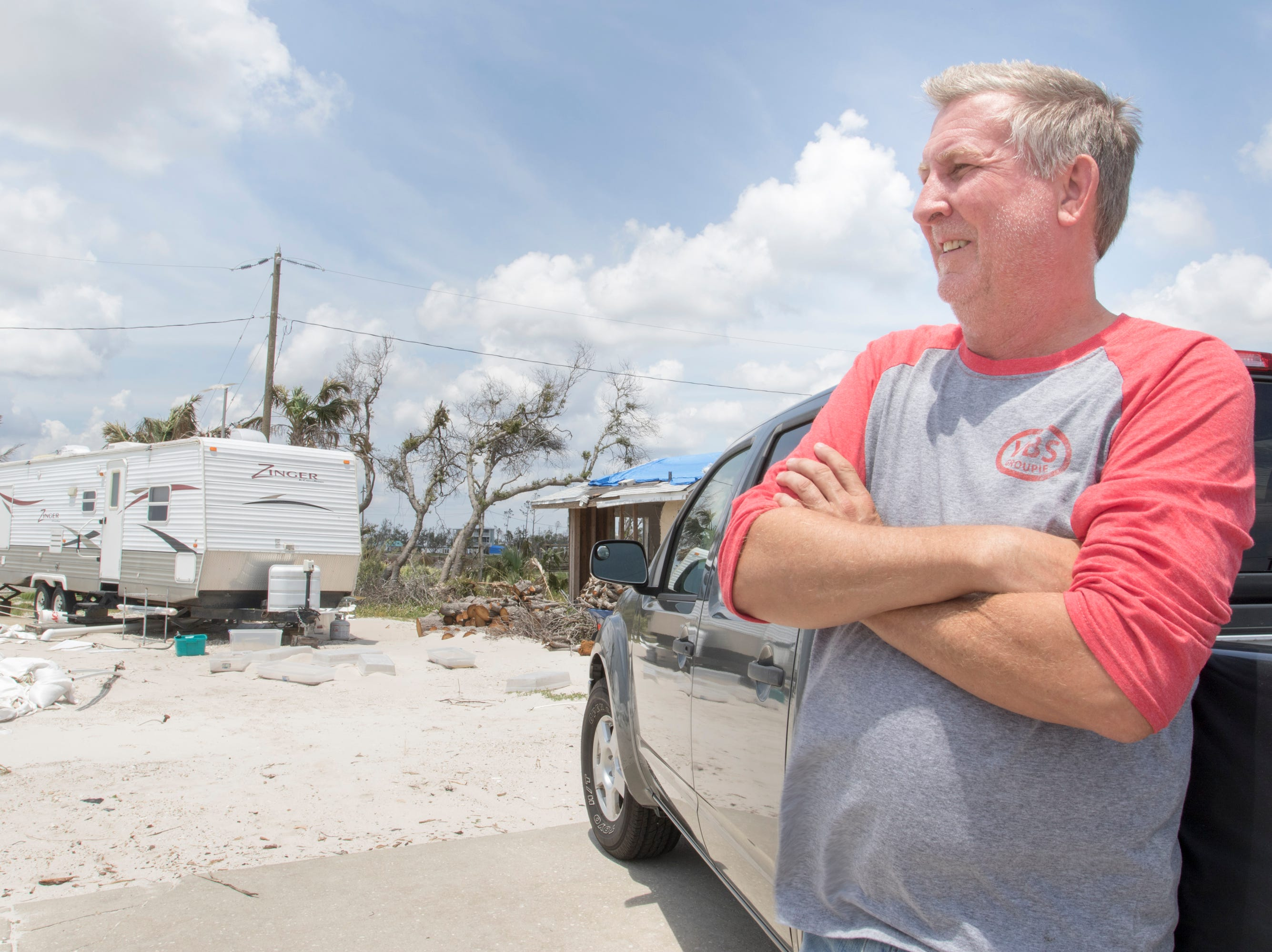 David Gieseking, pastor of Living Water Church at the Beach, looks out along Mexico Beach where his church once stood in the Panama City area of Florida on Wednesday, May 8, 2019.  Gieseking also lost his house and is now living in the RV on next to the foundation of his church.