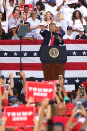 President Donald Trump takes the stage at his re-election campaign rally in Panama City Beach, Fla., on Wednesday, May 8, 2019.