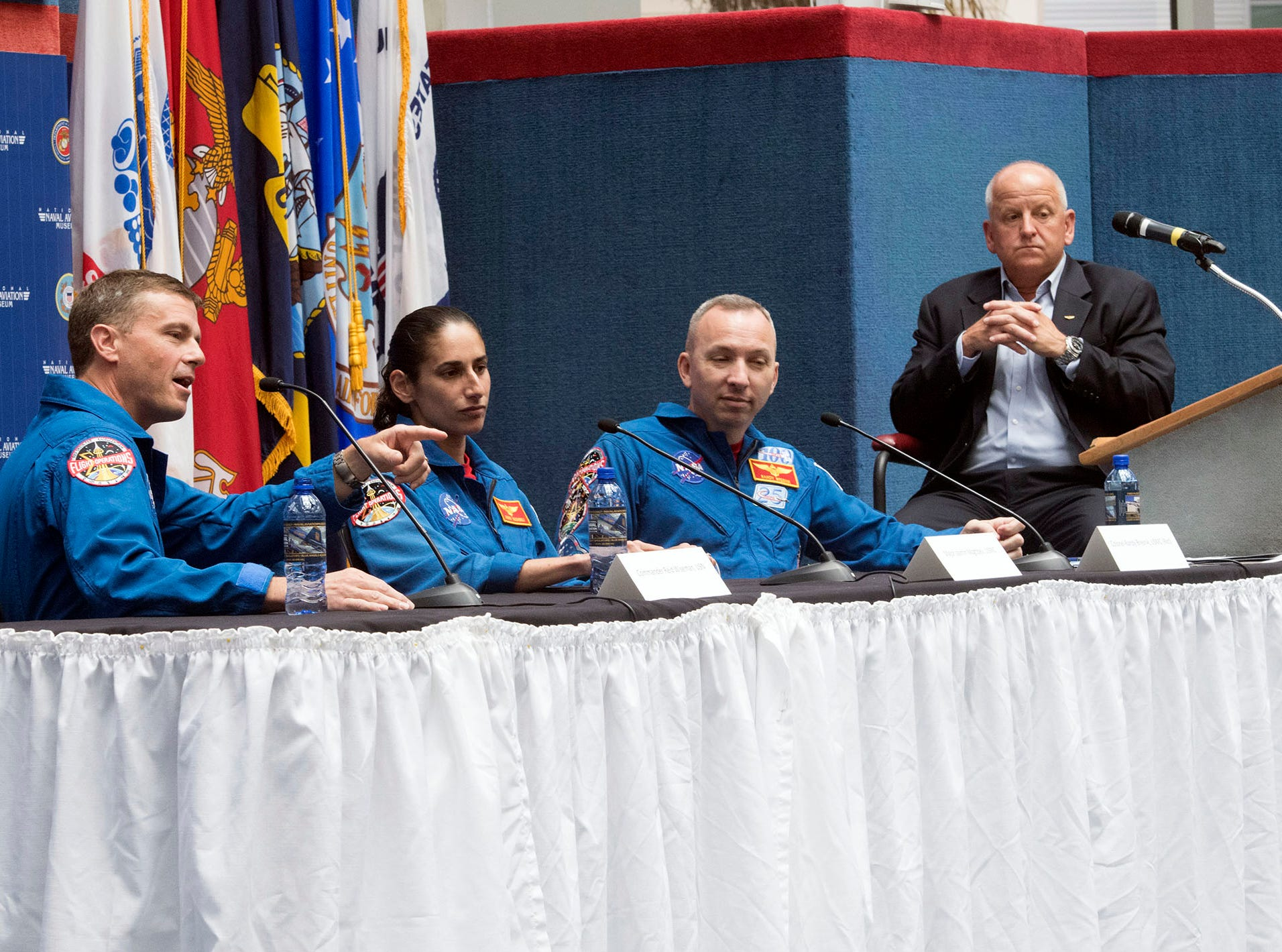 Naval Aviators, Cmdr. Reid Wiseman, Maj. Jasmin Moghbeli and Col. Randy Bresnik shares their experiences in the astronaut program during Naval Aviation Symposium at the National Naval Aviation Museum on Thursday, May 9, 2019.