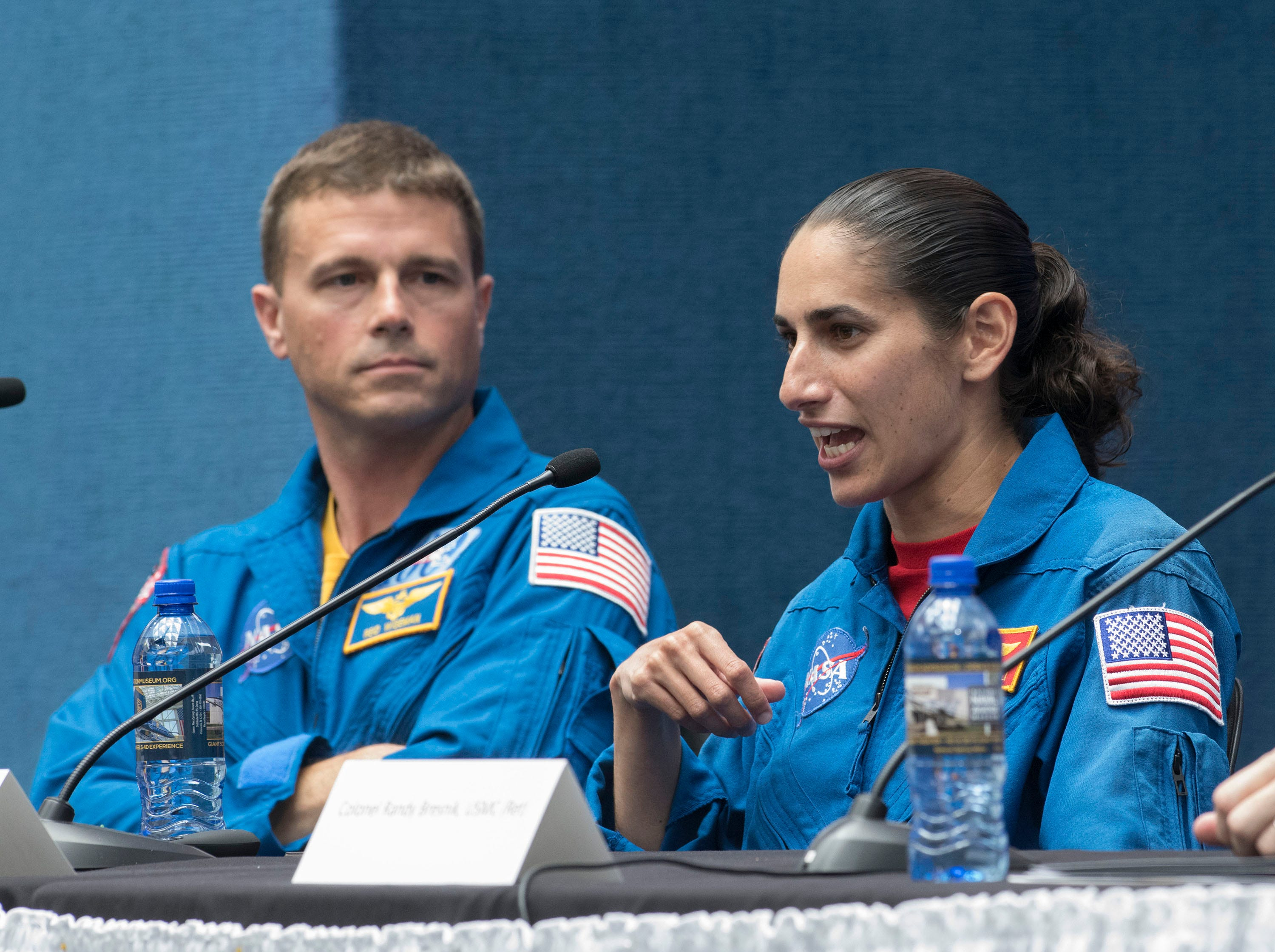 Maj. Jasmin Moghbeli describes her training as an astronaut during a panel discussion while fellow astronaut, Cmdr. Reid Wiseman looks on during the Naval Aviation Symposium on Thursday, May 9, 2019.