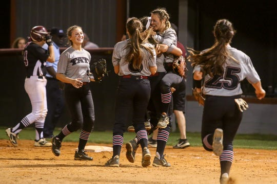 The Lady Aggies celebrate after beating Navarre 1-0 in the Region 1-7A quarterfinal game at Tate High School on Wednesday, May 8, 2019. Tate faces Niceville in the next round.
