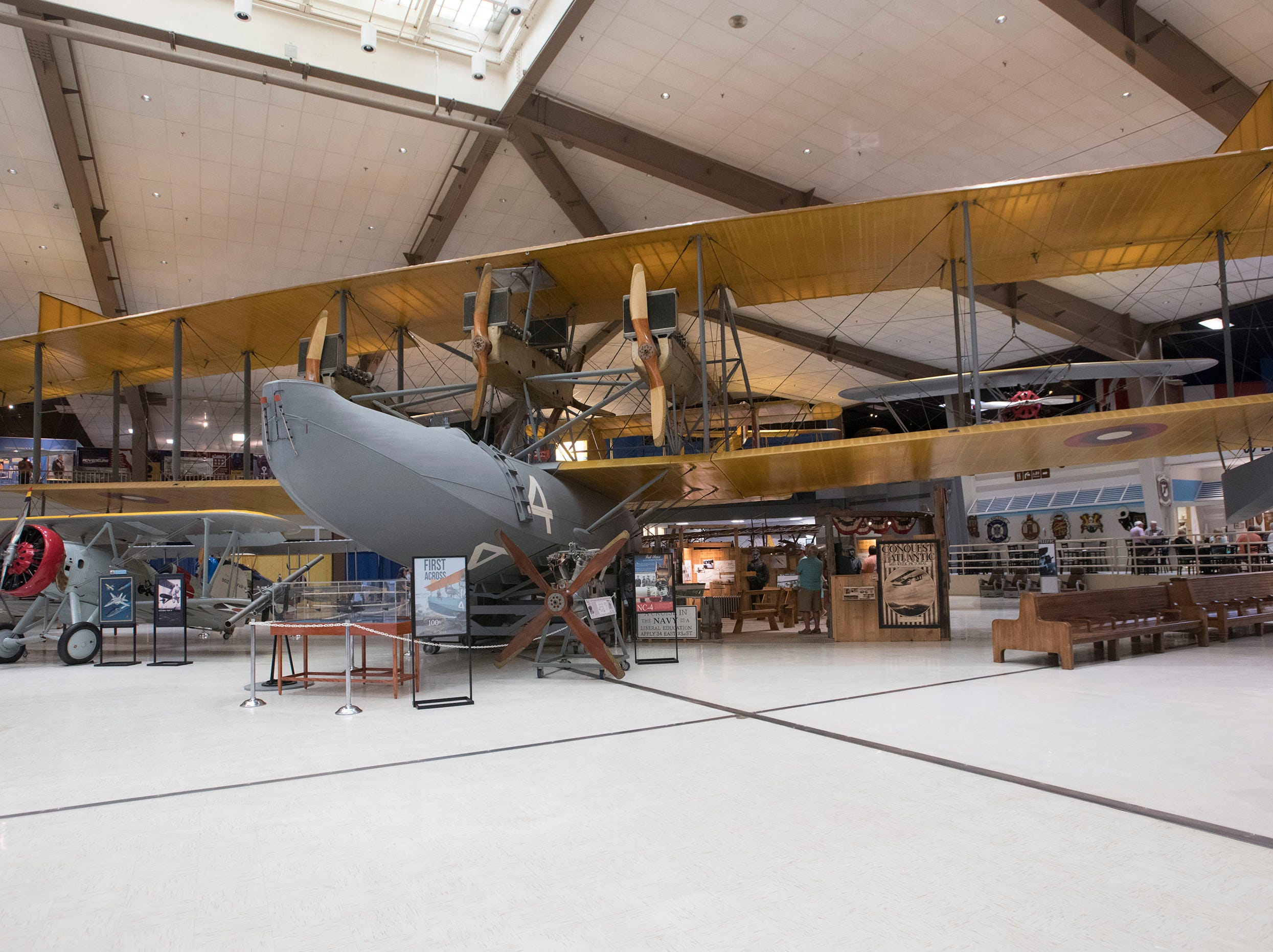 Visitors get a good look at the NC-4 seaplane on display at the National Naval Aviation Museum on Thursday, May 9, 2019. The National Naval Aviation Museum is celebrating the 100th anniversary of the Navy's flight across the Atlantic Ocean in May.
