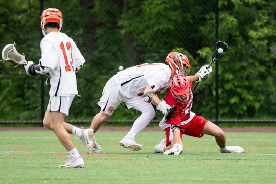 Susquehannock's Gavin Held slips as he controls the ball during a YAIAA lacrosse tournament semifinal game against Central York in Hanover on Wednesday, May 8, 2019.