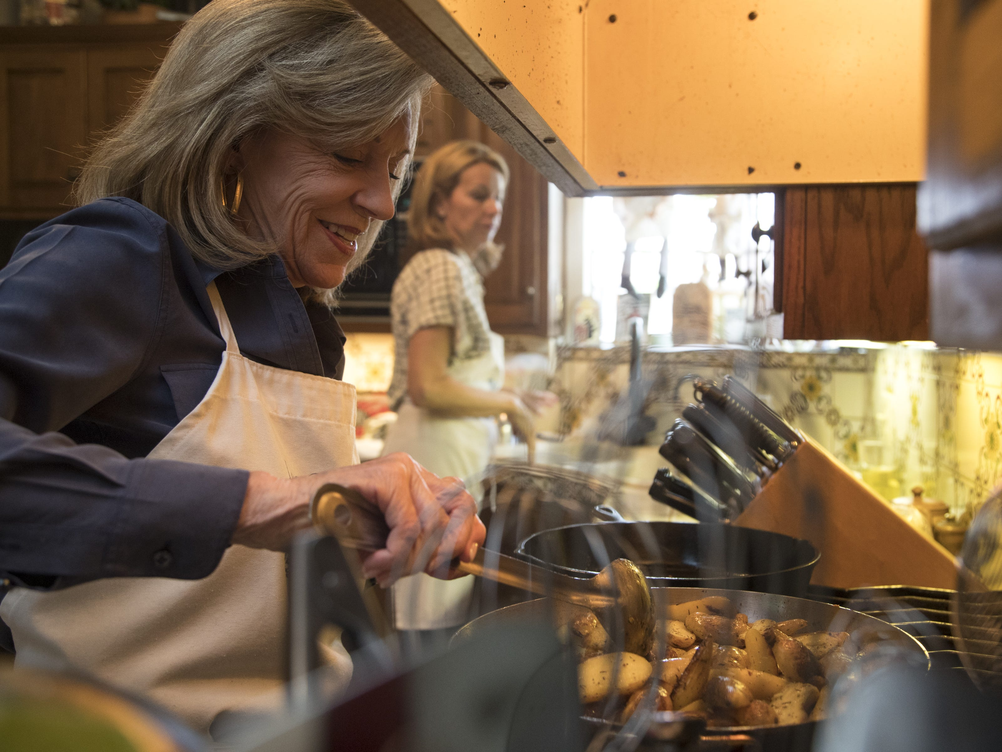 Barbara Fenzl works in the kitchen during a cooking class, May 7, 2019, at Les Gourmettes Cooking School, 6610 N. Central Ave., Phoenix.