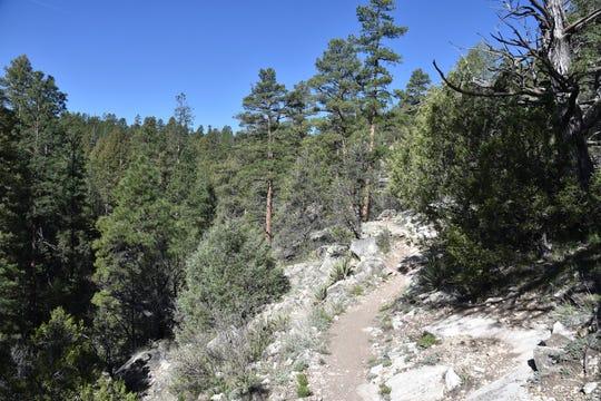 The trail hugs the canyon edge.
