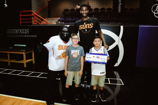 Phoenix Suns center Deandre Ayton takes picture with team mascot, Gorilla, Adrian Olvera and his younger brother, Gabriel, who was invited to join Ayton at next week's NBA Draft Lottery in Chicago.