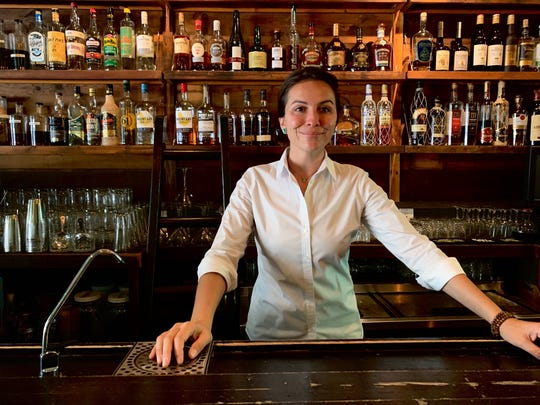 Chef Danielle Leoni behind the bar at her Downtown Phoenix restaurant, Breadfruit & Rum Bar.