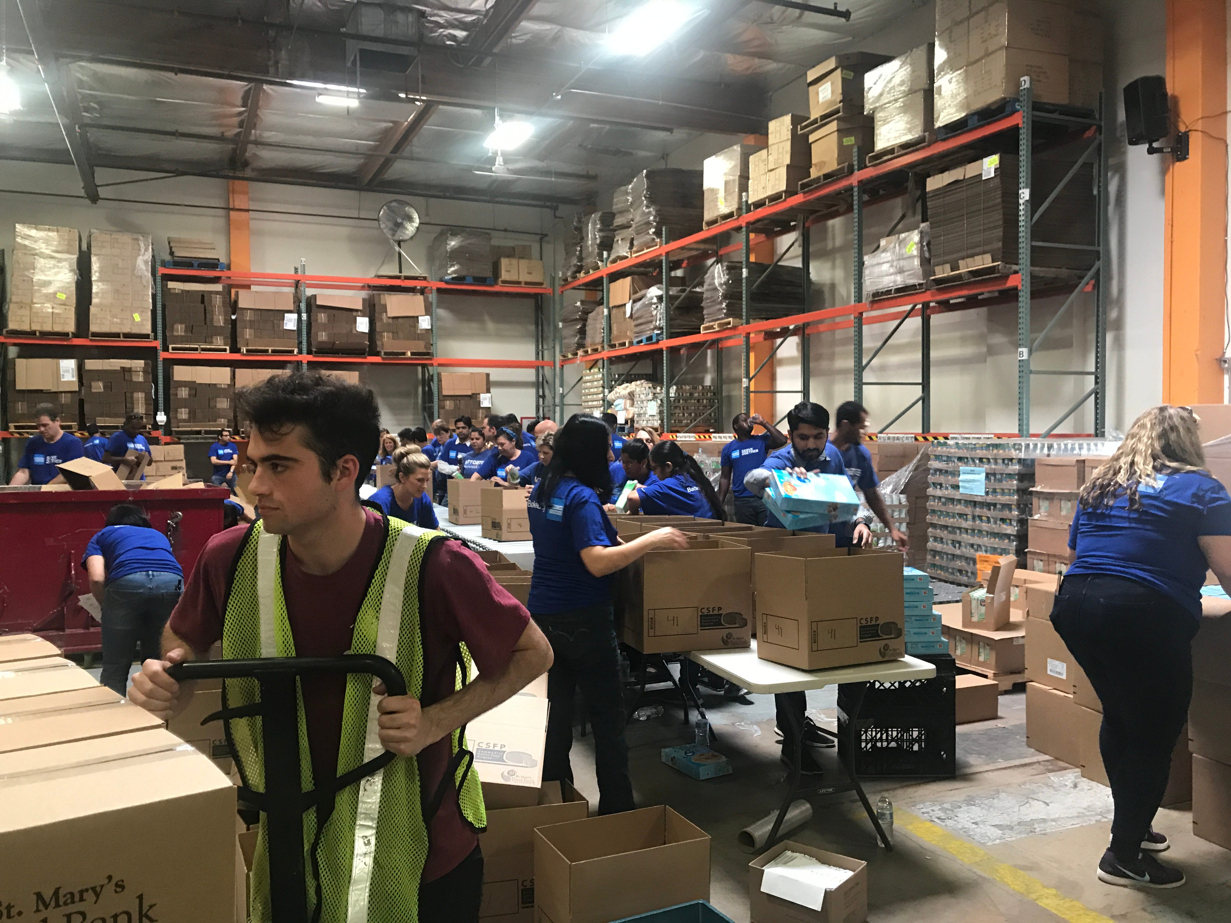 Volunteers at St. Mary's Food Bank pack emergency food boxes for families in need on May 9, 2019. St. Mary's distributes more than 40,000 emergency boxes each month.
