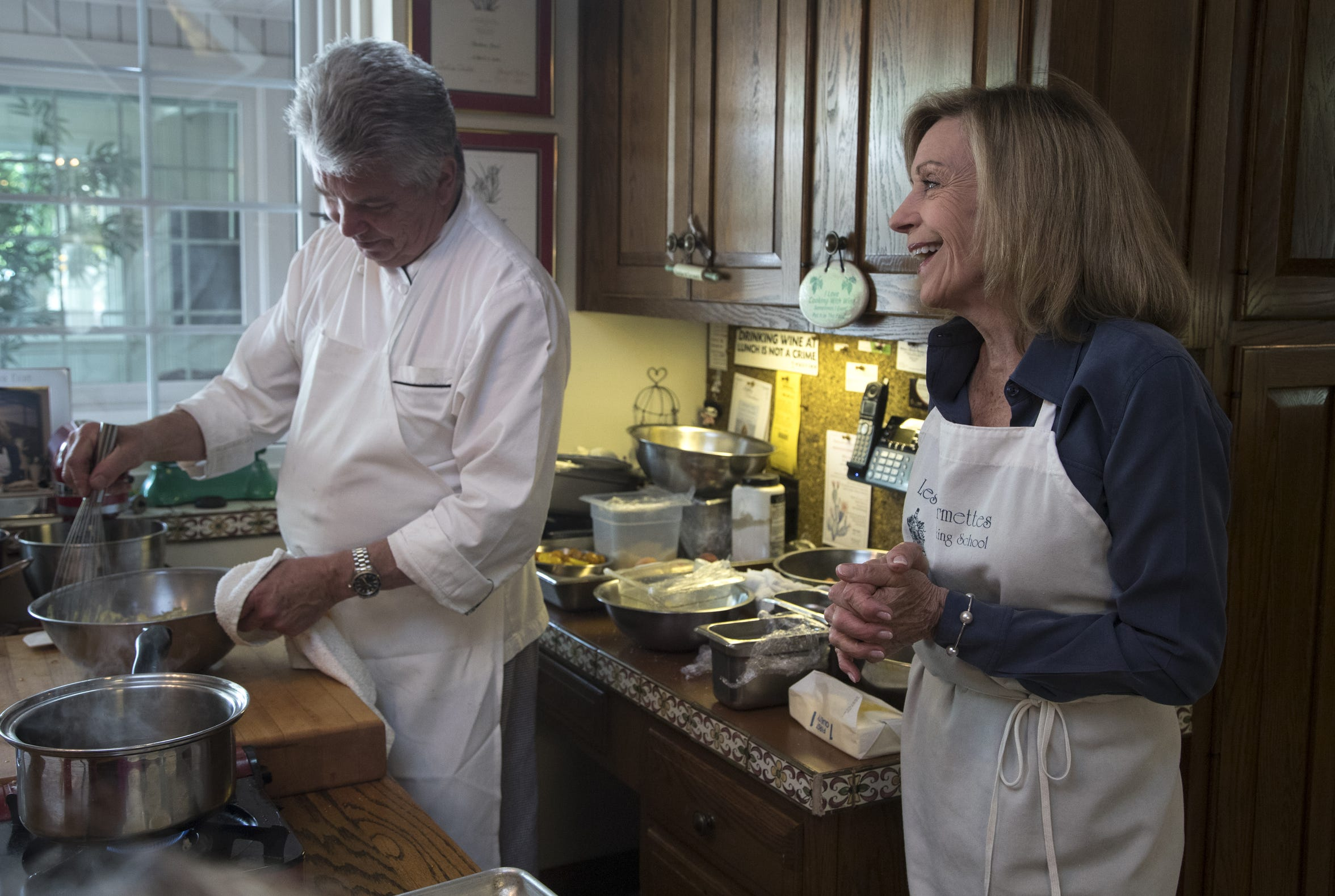 Barbara Fenzl (right) and chef Vincent Guerithault during a cooking class, May 7, 2019, at Les Gourmettes Cooking School, 6610 N. Central Ave., Phoenix.