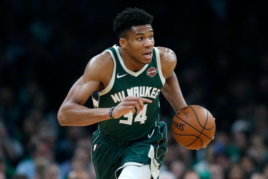 Milwaukee Bucks' Giannis Antetokounmpo brings the ball up court during the first half of Game 4 of a second round NBA basketball playoff series against the Boston Celtics in Boston, Monday, May 6, 2019. (AP Photo/Michael Dwyer)