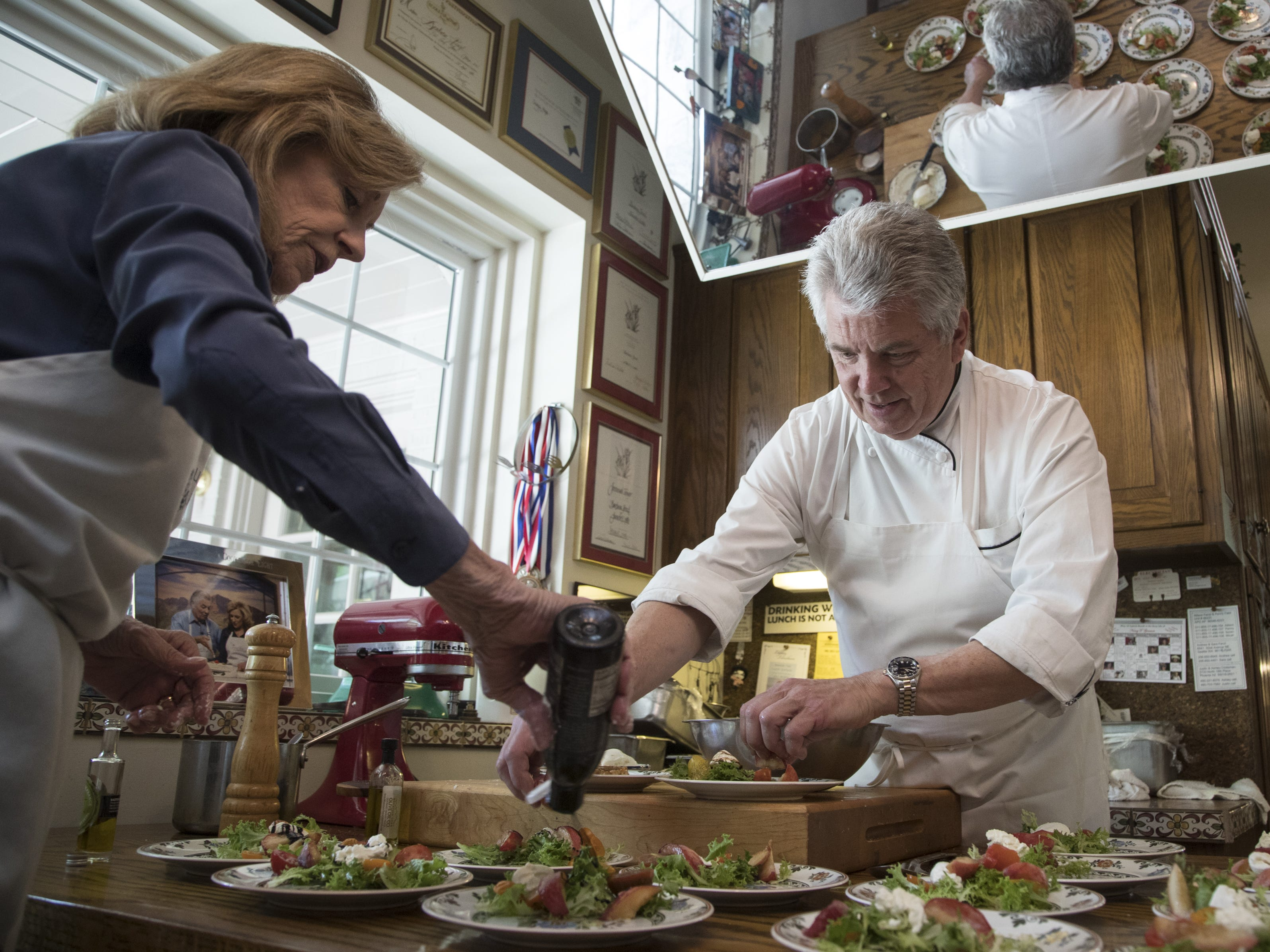 Barbara Fenzl (left) and chef Vincent Guerithault make salads during a cooking class, May 7, 2019, at Les Gourmettes Cooking School, 6610 N. Central Ave., Phoenix.