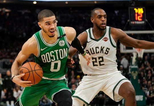Boston Celtics' Jayson Tatum tries to drive past Milwaukee Bucks' Khris Middleton during the second half of Game 5 of a second round NBA basketball playoff series Wednesday, May 8, 2019, in Milwaukee. The Bucks won 116-91 to win the series. (AP Photo/Morry Gash)