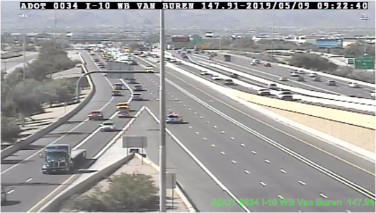 I-10 westbound closed at mini stack interchange due to rollover crash.