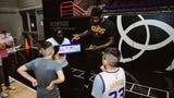 Phoenix Suns center Deandre Ayton shoots hoops with Suns fan Gabriel Olvera and his older brother, Adrian, with their parents watching Wednesday.