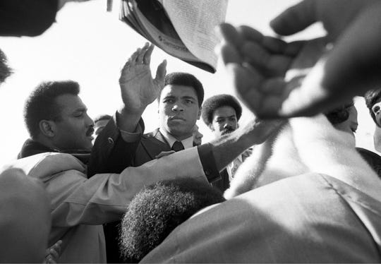 Fans welcome home boxer Muhammad Ali on Nov. 8, 1974.