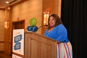 Elizabeth Montgomery serving as Master of Ceremonies for the Tempe YouthFest Courage Awards and Changemakers banquet.