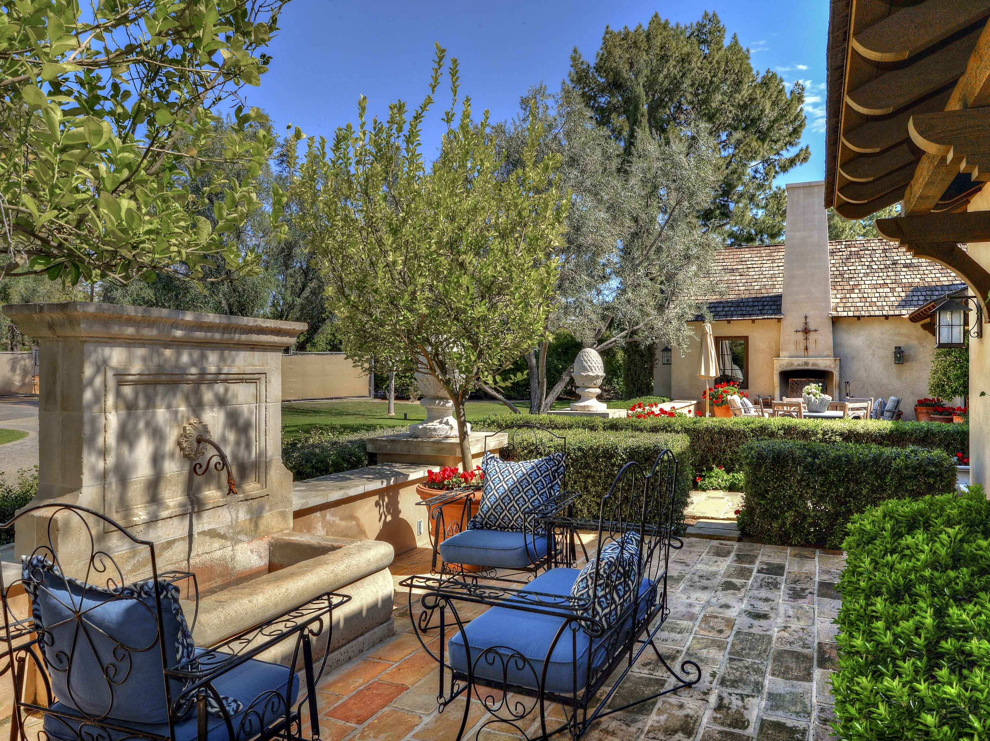 The $3.3M Paradise Valley home purchased by Bill and Susan Roach has a brick paved front courtyard.