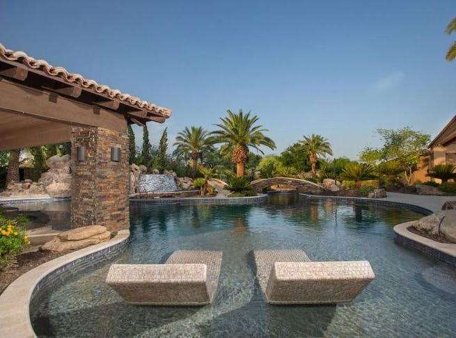 The Paradise Valley mansion, sold by Larry Fitzgerald, features a resort style pool with a lazy river and submerged lounge beds.