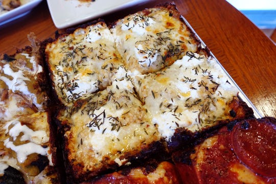 The White pizza with ricotta, garlic and thyme at The Rec Pizzeria in Peoria.