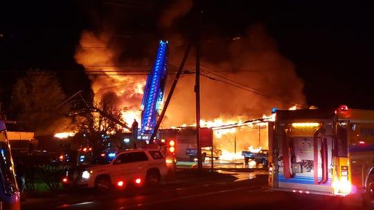 A massive fire damaged an Ellenville car dealership Thursday morning on Main Street.