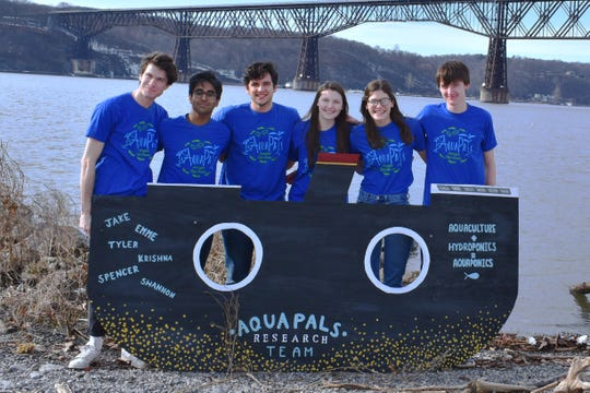 Arlington High School seniors Jacob Gaines, left to right, Krishna Koka, Spencer Koonin, Shannon Gibson, Emme Magliato and Tyler Locke, aka AquaPals, are the winners of the national Lexus Eco Challenge.