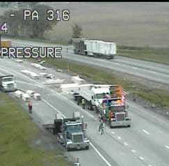 Nearly 26,000 pounds of lumber from tractor-trailer crash spread on I-81 south