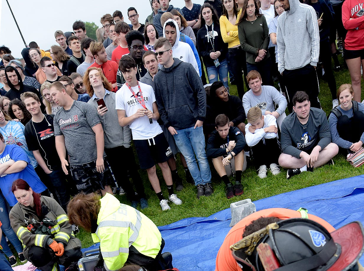 Students watch as emergency workers attend to a student victim during a mock car accident at the Dover Area High School Thursday, May 9, 2019. Local fire, ambulance and police volunteered for the event which reminds high school upperclassmen to be safe during prom season. Dover's prom in Saturday, May 11. Bill Kalina photo