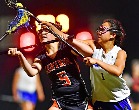 Central York's Hannah Cunningham, left, and Kennard-Dale's Jenna Soukaseum vie for control of the ball during girls' lacrosse semifinal action at South Western High School in Hanover, Wednesday, May 8, 2019. Kennard-Dale would win the game 19-10. Dawn J. Sagert photo