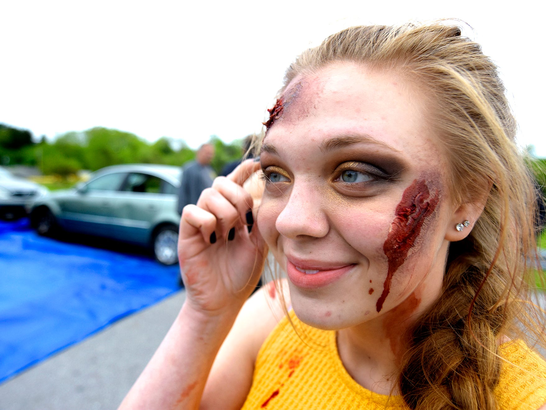 Dover High School mock accident victim, junior Victoria Brennan, waits to take her place during the staging of the accident at the Dover Area High School Thursday, May 9, 2019. Local fire, ambulance and police volunteered for the event which reminds high school upperclassmen to be safe during prom season. Dover's prom in Saturday, May 11. Bill Kalina photo