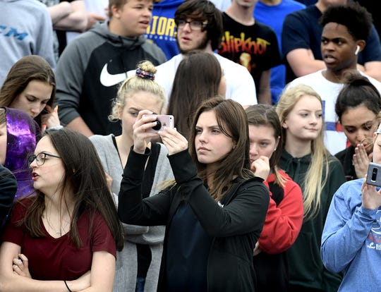 Dover High School junior Emily Shoemaker photographs a mock accident scene at the Dover Area High School Thursday, May 9, 2019. Local fire, ambulance and police volunteered for the event which reminds high school upperclassmen to be safe during prom season. Dover's prom in Saturday, May 11. Bill Kalina photo