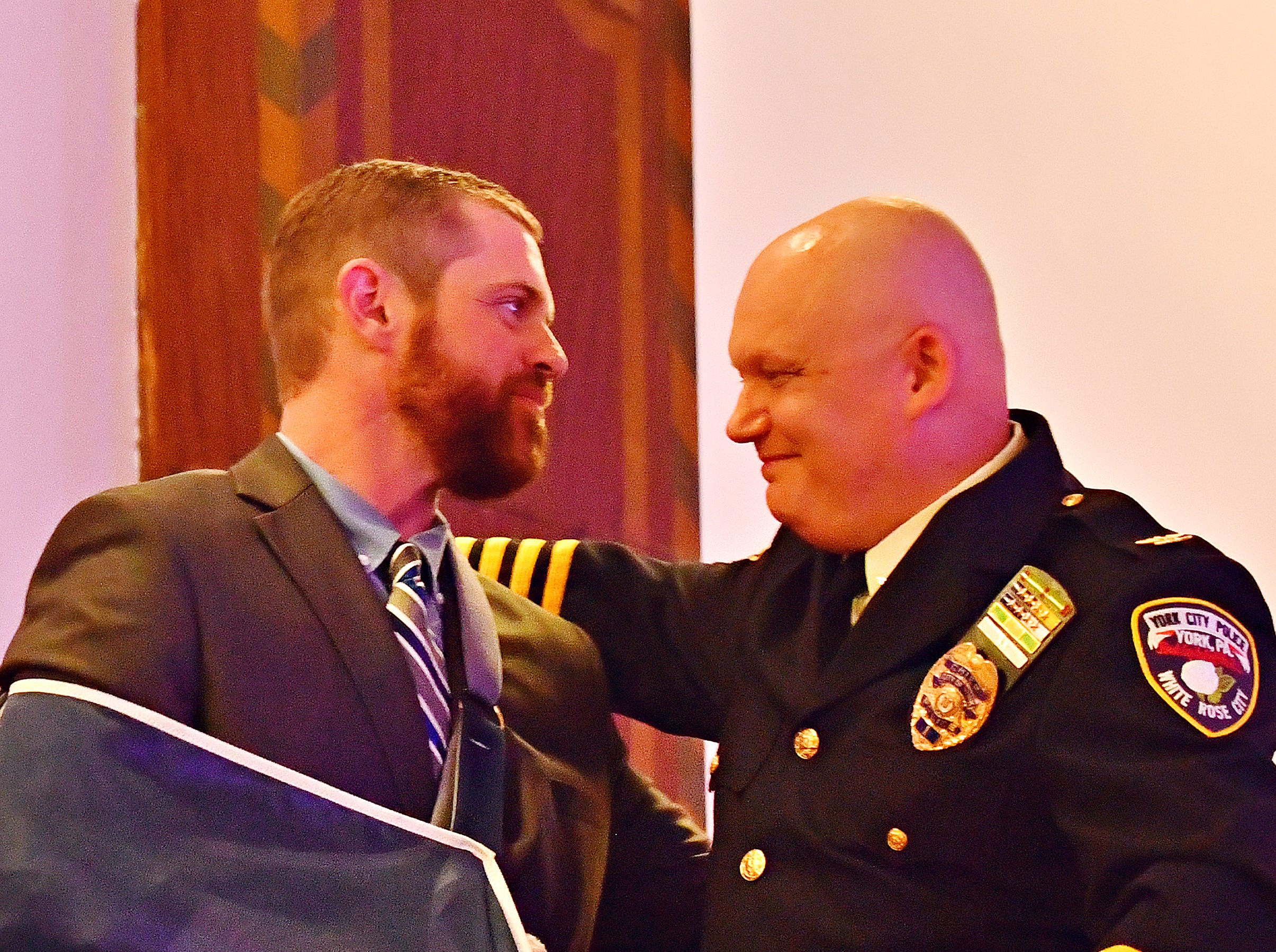 """Police Officer Kyle Pitts, left, is presented with the 2018 """"Police Officer of the Year"""" award by York City Police Chief Troy Bankert during the York City Police Departmental Awards Ceremony at Valencia Ballroom in York City, Thursday, May 9, 2019. Dawn J. Sagert photo"""