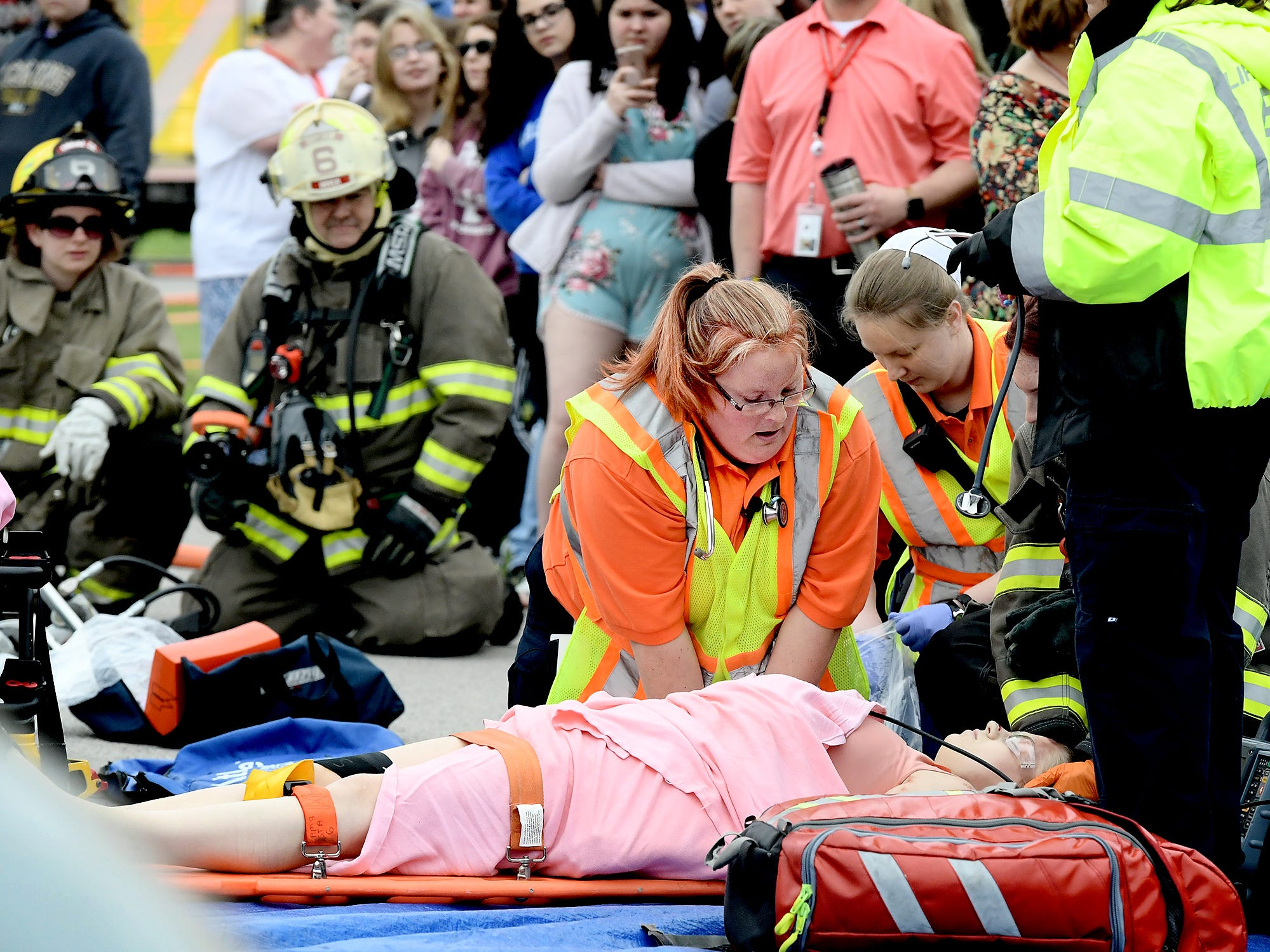 Emergency workers attend to a victim during a mock car accident at the Dover Area High School Thursday, May 9, 2019. Local fire, ambulance and police volunteered for the event which reminds high school upperclassmen to be safe during prom season. Dover's prom in Saturday, May 11. Bill Kalina photo