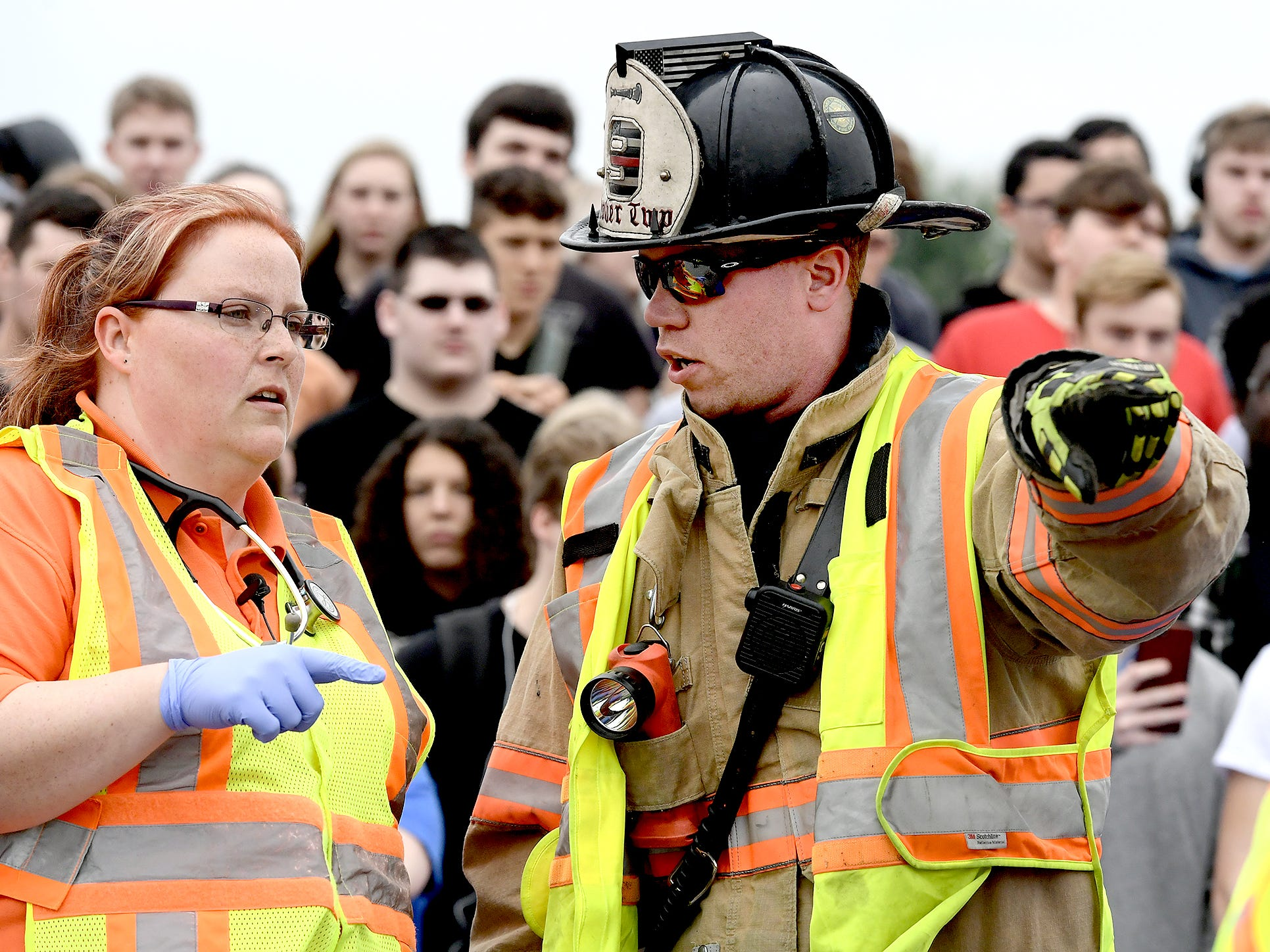 Emergency workers confer during a mock car accident at the Dover Area High School Thursday, May 9, 2019. Local fire, ambulance and police volunteered for the event which reminds high school upperclassmen to be safe during prom season. Dover's prom in Saturday, May 11. Bill Kalina photo