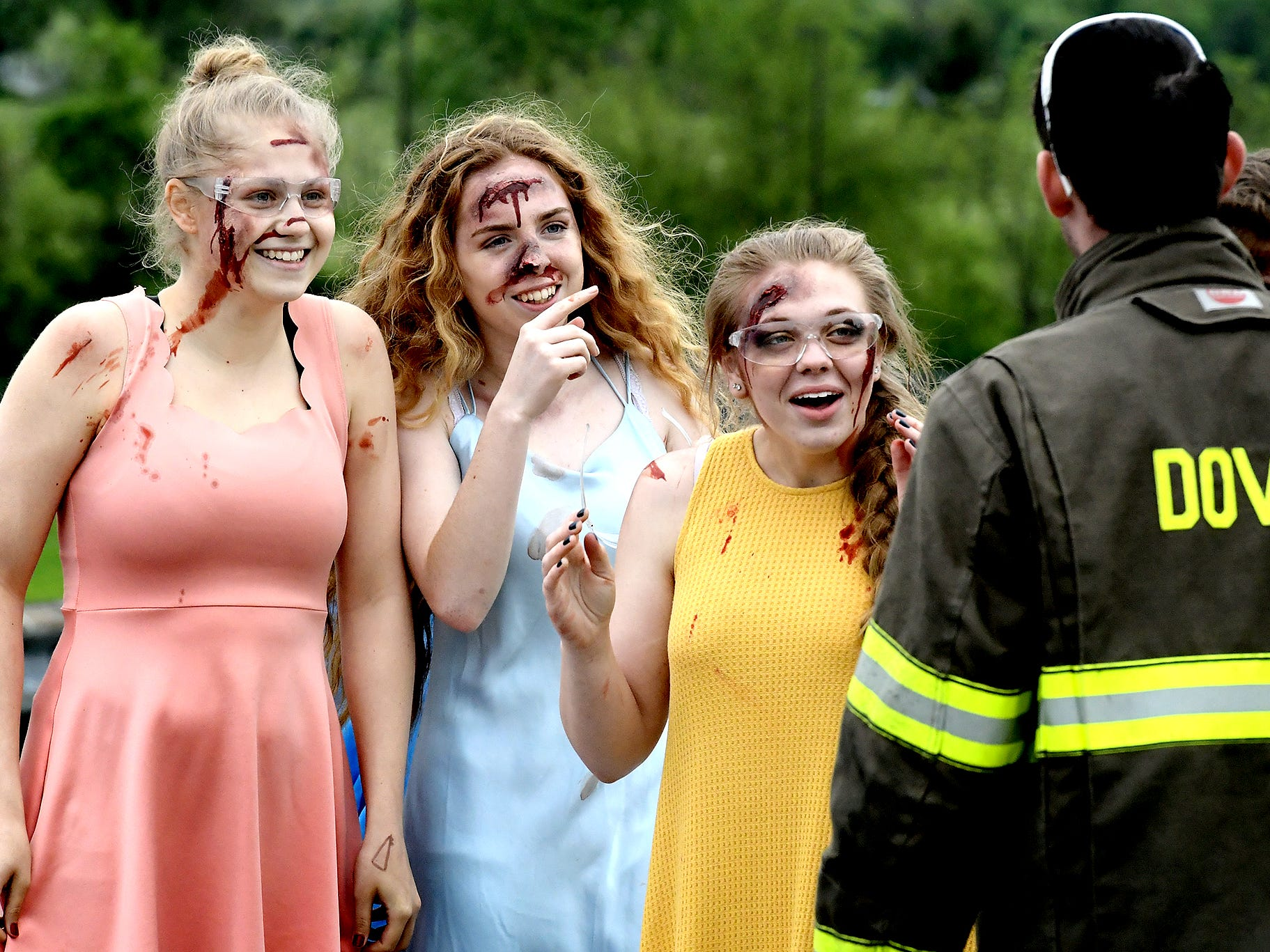 Dover High School mock accident victims, from left, senior Abby Diehl, senior Chayce Hoffman and junior Victoria Brennan are briefed prior to the staging of the accident at the Dover Area High School Thursday, May 9, 2019. A fellow student administered makeup to the acting victims. Local fire, ambulance and police volunteered for the event which reminds high school upperclassmen to be safe during prom season. Dover's prom in Saturday, May 11. Bill Kalina photo
