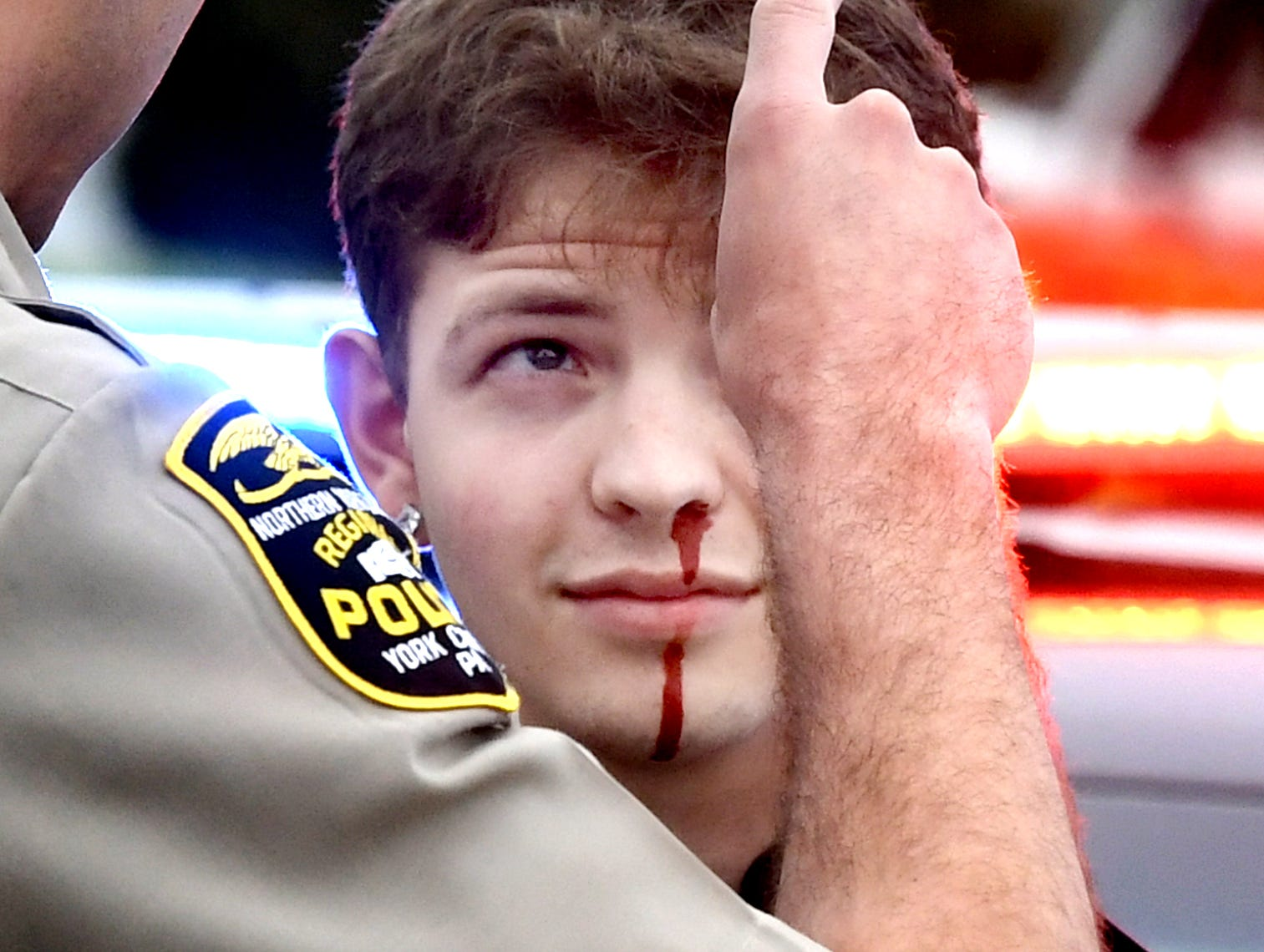 Dover Area High School senior Bronson Bitner is checked for sobriety during a mock car accident at the Dover Area High School Thursday, May 9, 2019. Local fire, ambulance and police volunteered for the event which reminds high school upperclassmen to be safe during prom season. Dover's prom in Saturday, May 11. Bill Kalina photo