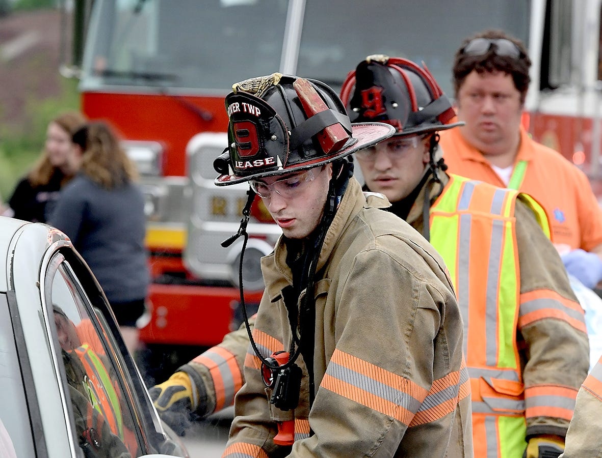 Emergency workers extricate a victim during a mock car accident at the Dover Area High School Thursday, May 9, 2019. Local fire, ambulance and police volunteered for the event which reminds high school upperclassmen to be safe during prom season. Dover's prom in Saturday, May 11. Bill Kalina photo