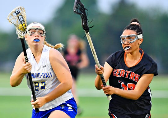 Kennard-Dale's Victoria Baublitz, left, works to maintain control of the ball while Central York's Sydni Cravens stays close during girls' lacrosse semifinal action at South Western High School in Hanover, Wednesday, May 8, 2019. Kennard-Dale would win the game 19-10. Dawn J. Sagert photo