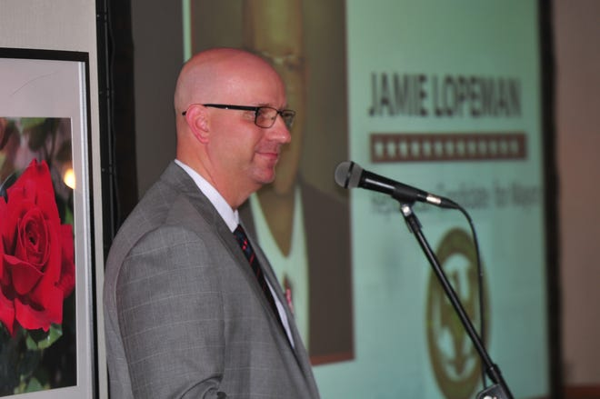 Jamie Lopeman speaks to an audience gathered Wednesday evening in the William G. Scott House for him to officially announce his candidacy for mayor.