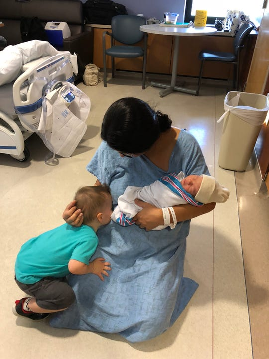 Reporter Victoria Freile introduces her two sons two-year-old Joe and 1-day-old Luke last fall.