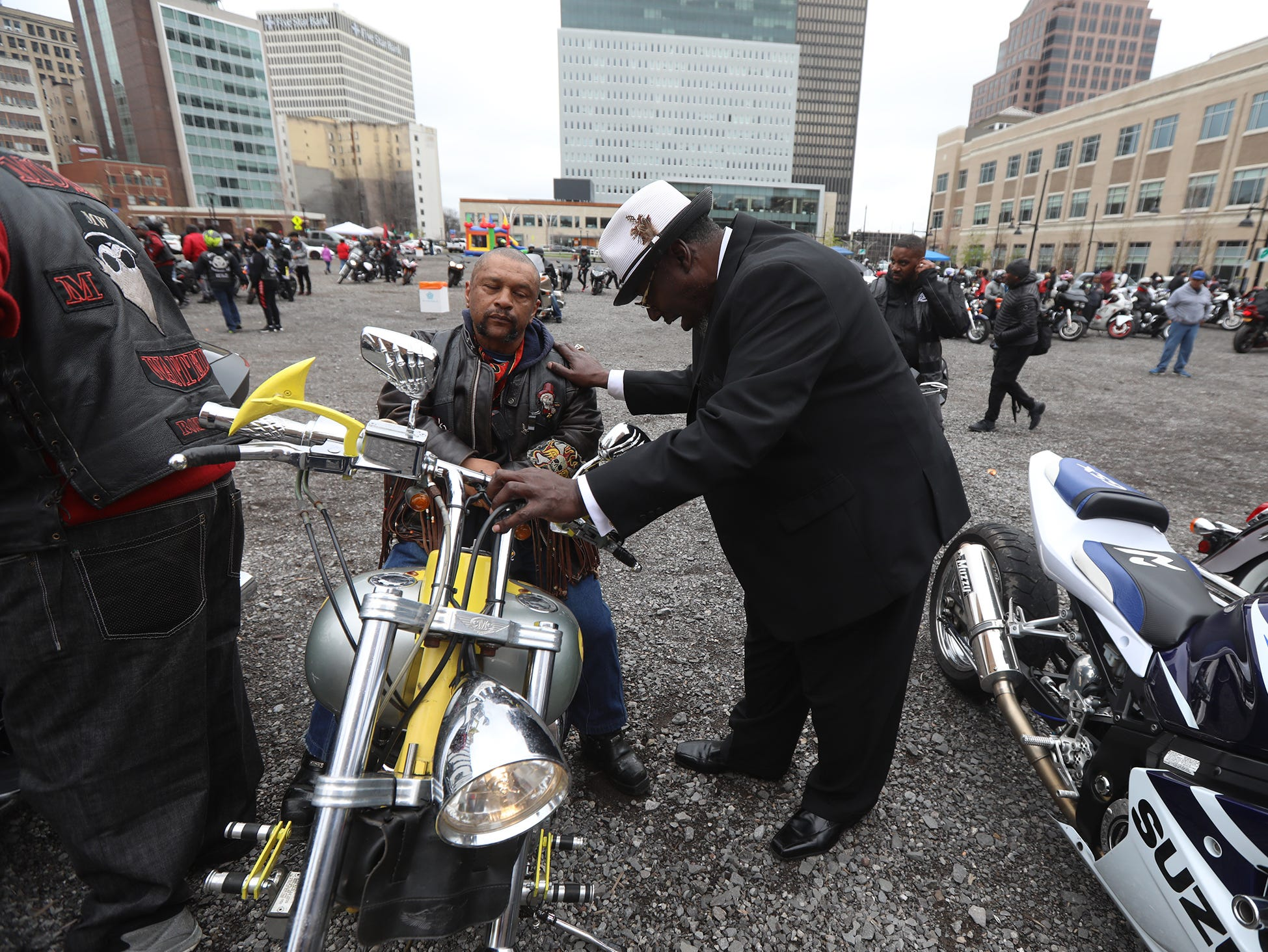 THE PHOTO:  Motorcycle clubs get their blessing of the season.  One of the deacons blessing riders and motorcycles, Deacon Ronald Gardner, with Greater Harvest Church, blesses Lucky Lyons.  FROM TINA:  I was between assignments and before heading out to the next, I ran over to get the blessing.  I knew it would make a nice photo and glad I didn't miss it.  It wasn't an assignment but I couldn't resist trying to capture something different.