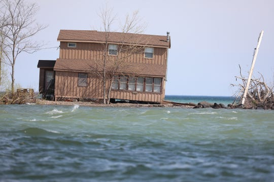 A house on Charles Point, Crescent Beach, in Sodus Bay has lost some of its foundation.