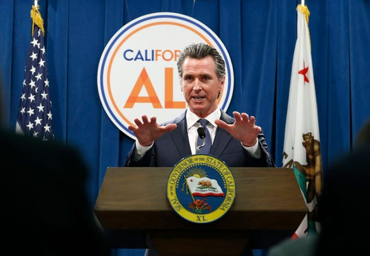 Gov. Gavin Newsom discusses his revised 2019-2020 state budget during a news conference Thursday, May 9, 2019, in Sacramento, Calif. Newsom, a Democrat, has proposed a $213.5 billion a spending plan. (AP Photo/Rich Pedroncelli)
