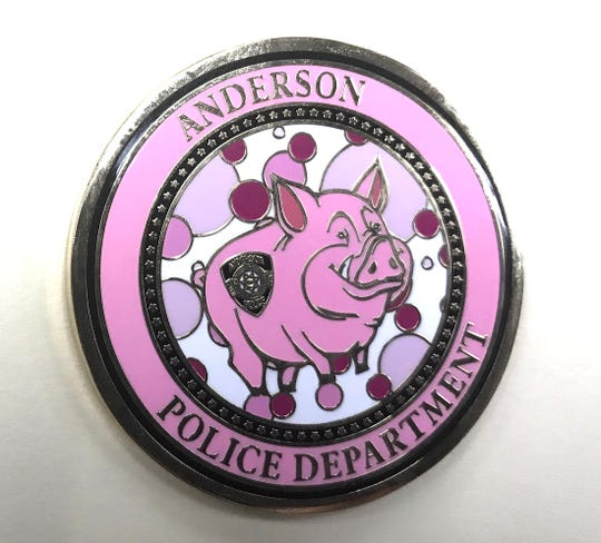 The Anderson Police Department had these medallions made in honor of Think Pink raising awareness of breast cancer.