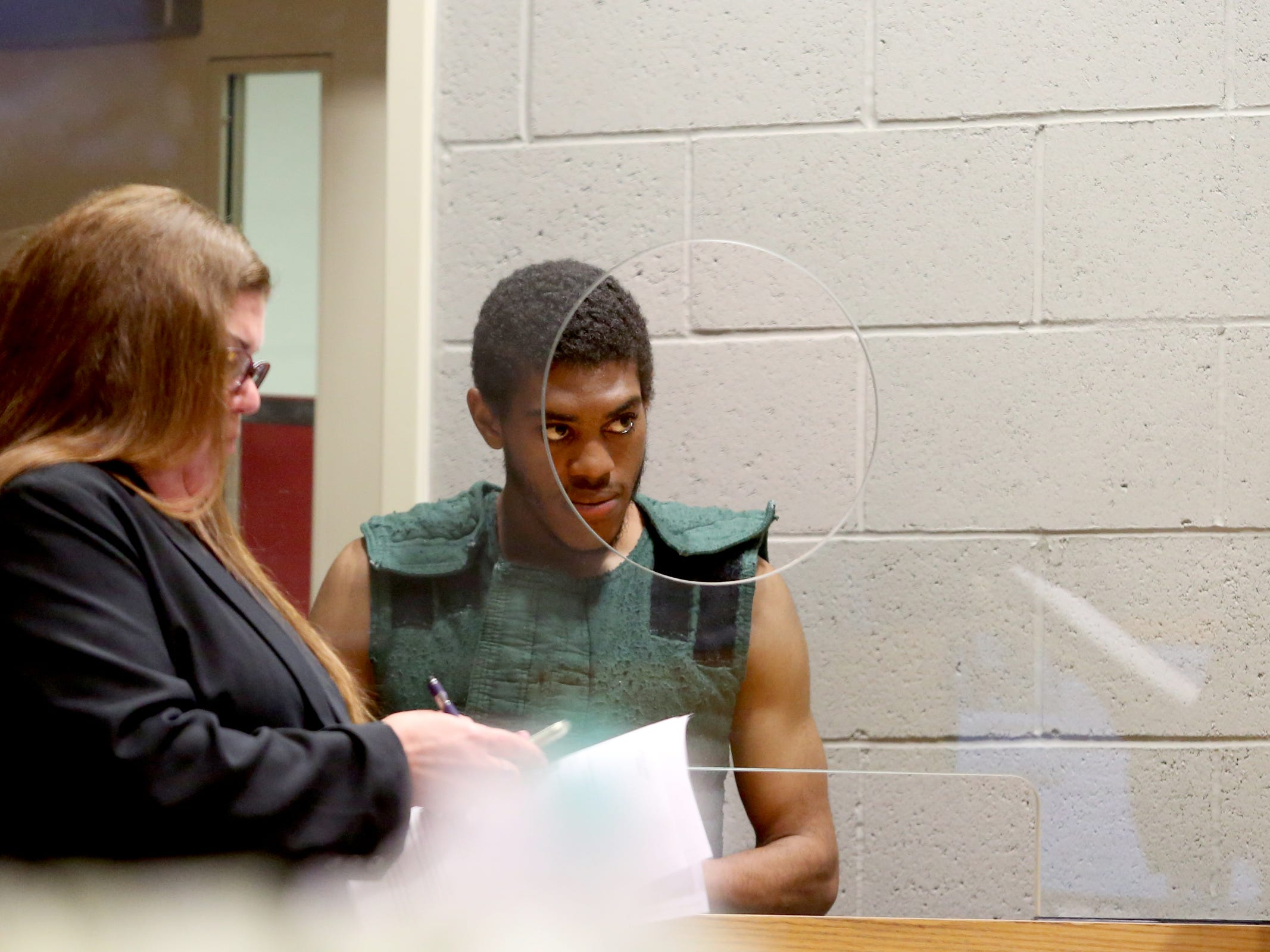 Keonte Caldwell appears with defense attorney Jane Claus for his arraignment on two aggravated murder charges and one attempted aggravated murder charge at the Marion County Court Annex in Salem on May 9, 2019. He and another man charged in the shooting are both being held without bail.