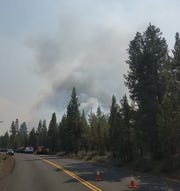 Smoke rises from a brush fire near LaPine, Oregon Wednesday, May 9, 2019.