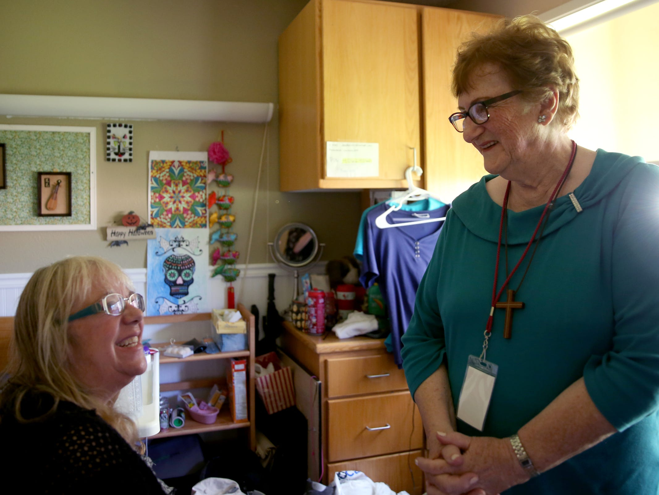 Volunteer Nadine Owings, right, chats with Melody Griffiths during a visit by the Friendship Brigade, a group of volunteers that focuses on spreading awareness about senior isolation and loneliness, at The Oaks at Sherwood Park in in Keizer on May 9, 2019.
