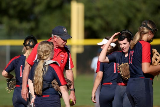 Kennedy head coach Walt Simmons talks to his team on the mound in the Santiam vs. Kennedy softball game at Kennedy High School in Mt. Angel on May 8, 2019. Kennedy won the game 15-5 in five innings.